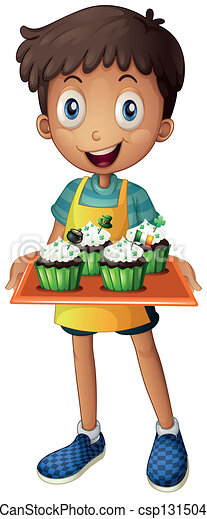 A young boy holding a tray with cupcakes - csp13150450