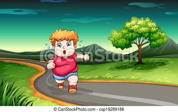 A young boy jogging - csp19289186