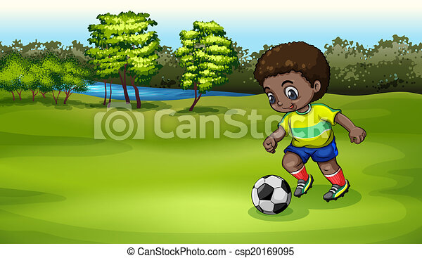 A young boy playing soccer near the river - csp20169095