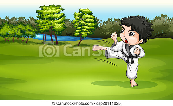 A young boy practicing karate near the river - csp20111025
