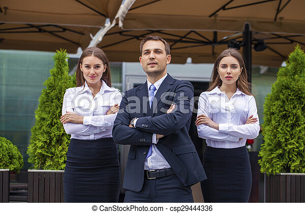 A young businessman with their secretaries - csp29444336