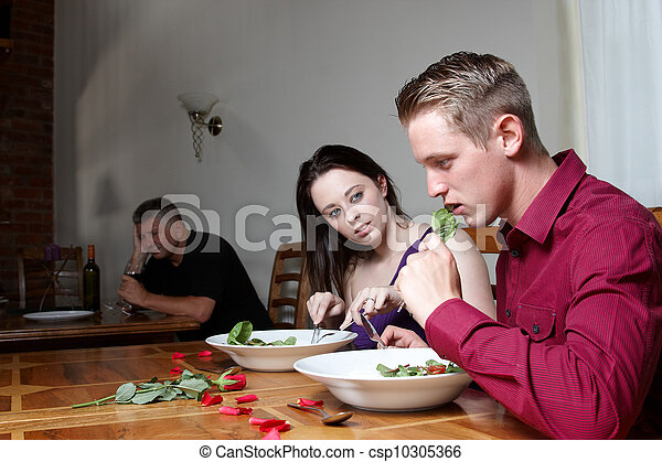 A young couple having a meal together - csp10305366