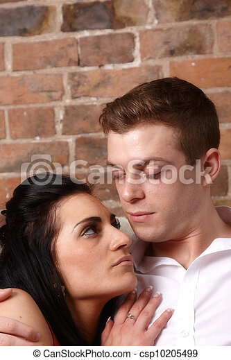 A young couple holding each other - csp10205499