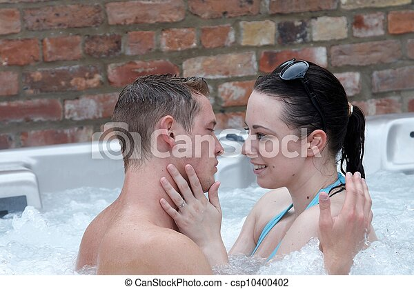 A young couple in a jacuzzi - csp10400402