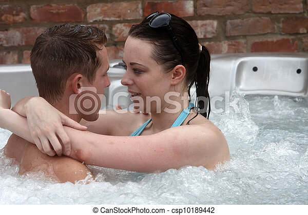 A young couple in the jacuzzi - csp10189442