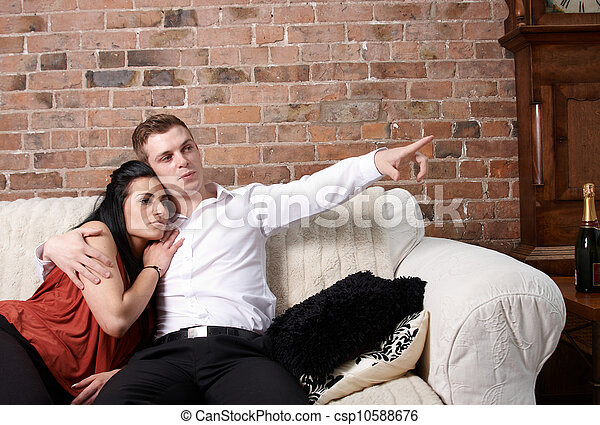 A young couple sitting close - csp10588676