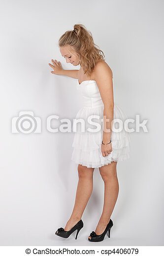 A young girl in a white dress and black