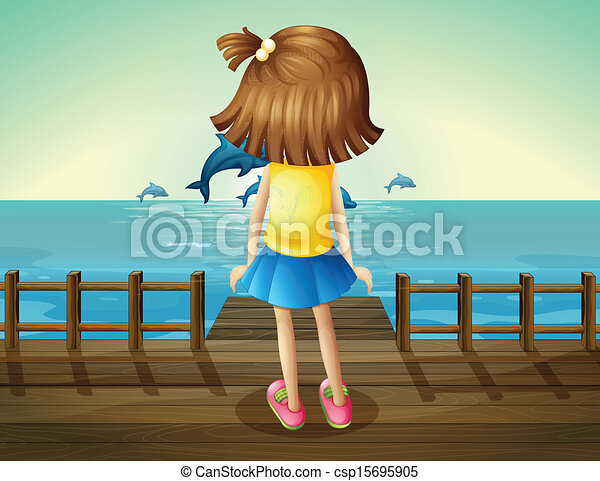 A young girl watching the dolphins - csp15695905