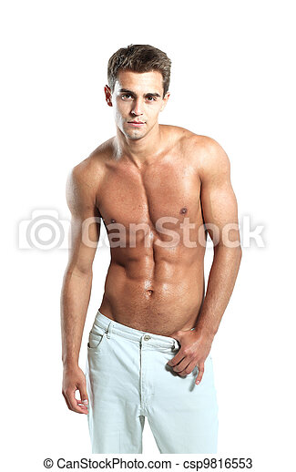 a young male model posing his muscles - csp9816553