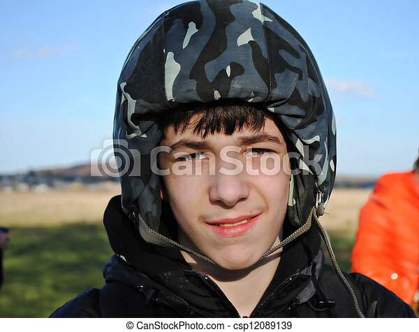 A young man in a helmet - csp12089139