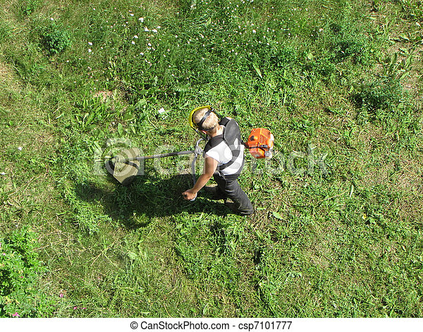 A young man mowing the grass - csp7101777
