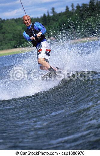 A young man water skiing - csp1888976