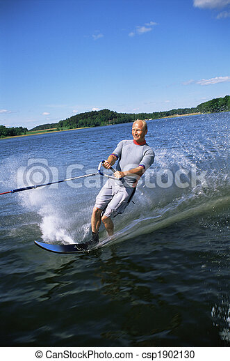 A young man water skiing - csp1902130