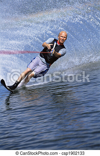 A young man water skiing - csp1902133
