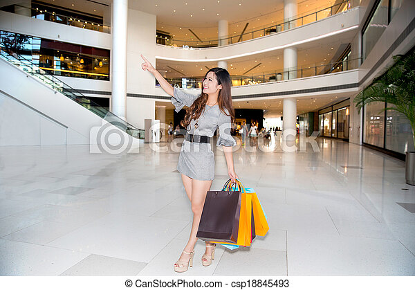 a young woman shopping in mall - csp18845493