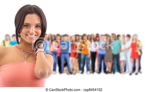 a young woman with big group of the young smiling students. Over white background - csp8454152