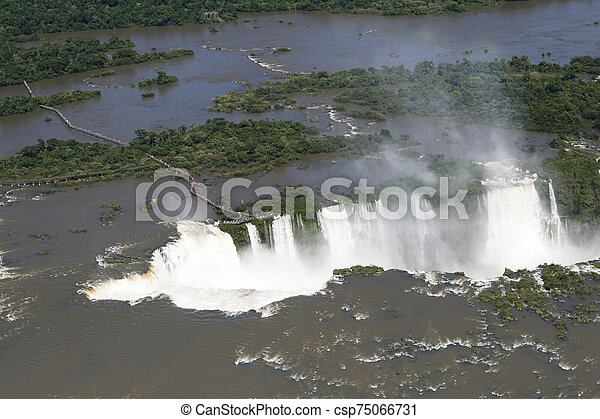 Aaerial view of Iguazu waterfalls from helicopter. Border of Brazil and Argentina. - csp75066731