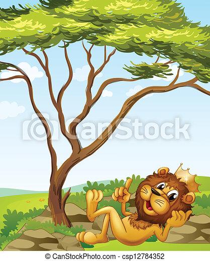 Un león rey tirado junto al árbol - csp12784352