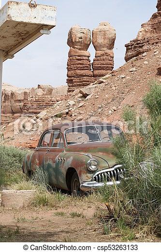 Abandoned car in Arizona canyons - csp53263133