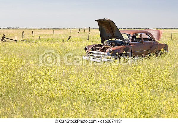 abandoned car in field - csp2074131