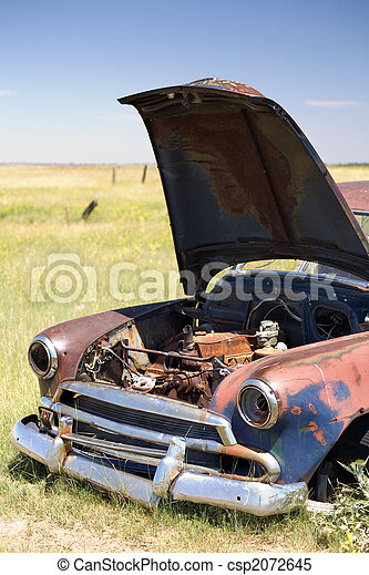 abandoned car in field - csp2072645