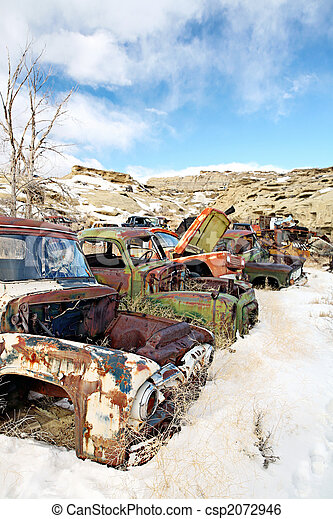 abandoned cars in junkyard - csp2072946