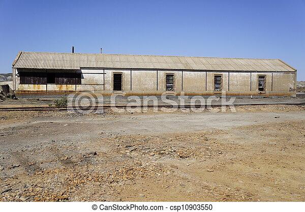 Abandoned empty warehouse - csp10903550
