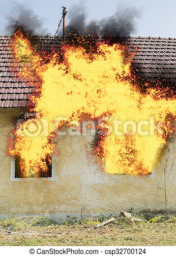 Abandoned house on fire - csp32700124
