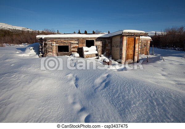 Abandoned log cabin in winter - csp3437475