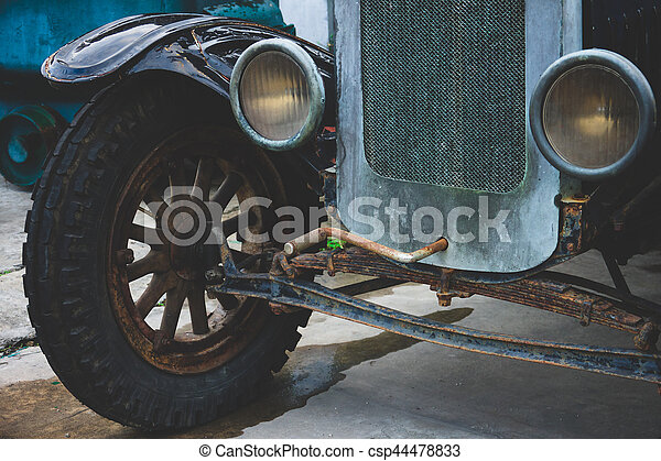 Abandoned vintage car wheels and headlight - Classic vehicles - csp44478833