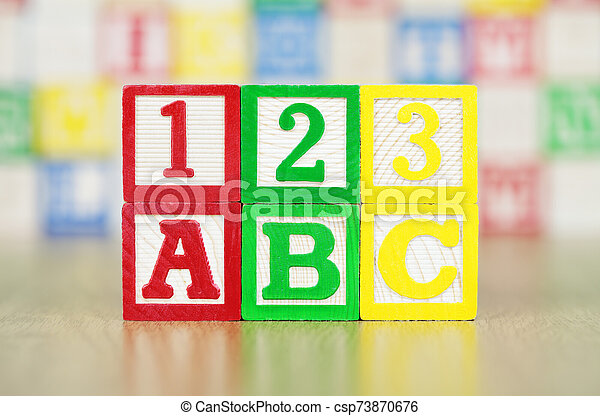 ABC and 123 Spelled Out in Alphabet Building Blocks - csp73870676