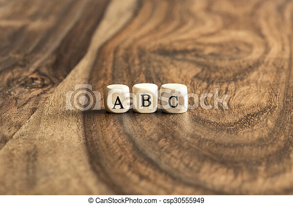 ABC blocks on wooden background - csp30555949