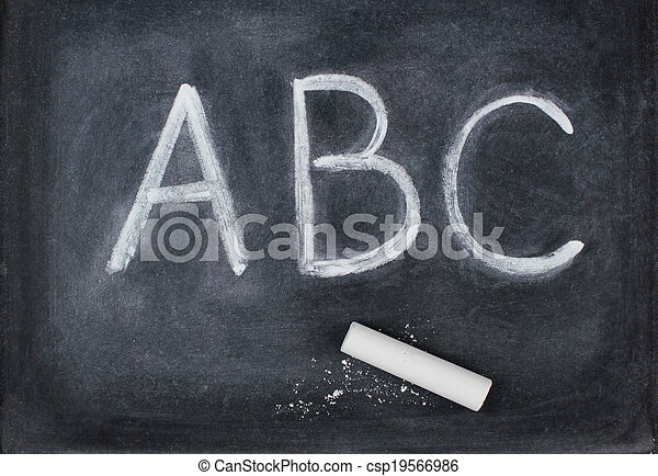 abc letters and chalk on blackboard close up