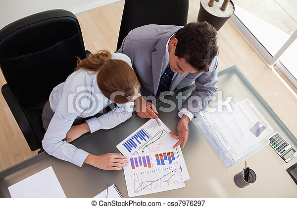 Above view of consultant analyzing data with her client - csp7976297