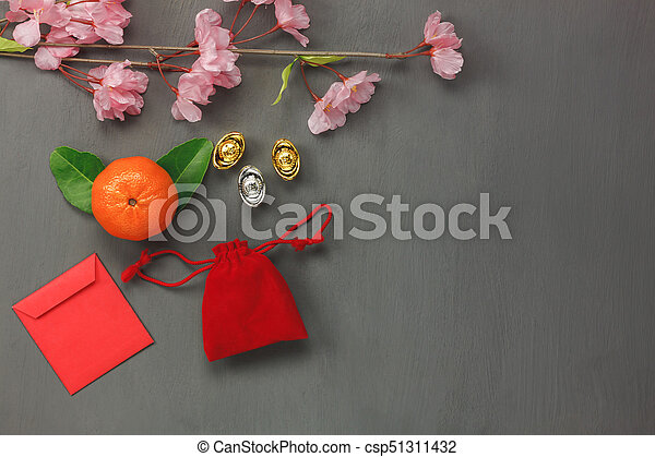 Above view of decorations Chinese & lunar New Year concept backgrounds.many objects is sign of the season.items on classic grey grunge home table.Other language means wealthy or rich and happiness. - csp51311432