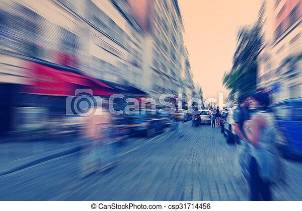 Abstract background. Boulevard Montmartre in Paris - radial zoom blur effect defocusing filter applied, with vintage instagram look. - csp31714456