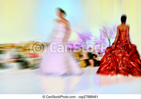 Abstract background - fashion models on catwalk - radial zoom blur effect defocusing filter applied, with vintage instagram look. - csp27888461