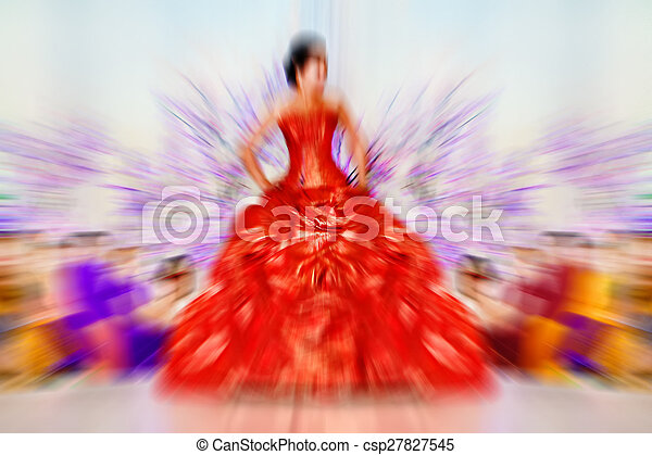 Abstract background - fashion models on catwalk - radial zoom blur effect defocusing filter applied, with vintage instagram look. - csp27827545