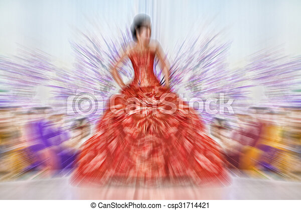 Abstract background - fashion models on catwalk - radial zoom blur effect defocusing filter applied, with vintage instagram look. - csp31714421