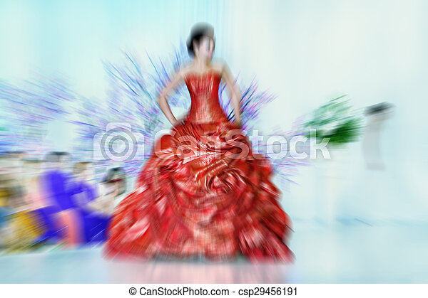Abstract background - fashion models on catwalk - radial zoom blur effect defocusing filter applied, with vintage instagram look. - csp29456191