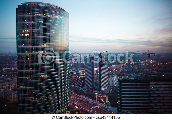 Abstract background of skyscrapers at night in Moscow. Panorama the evening city - csp43444155