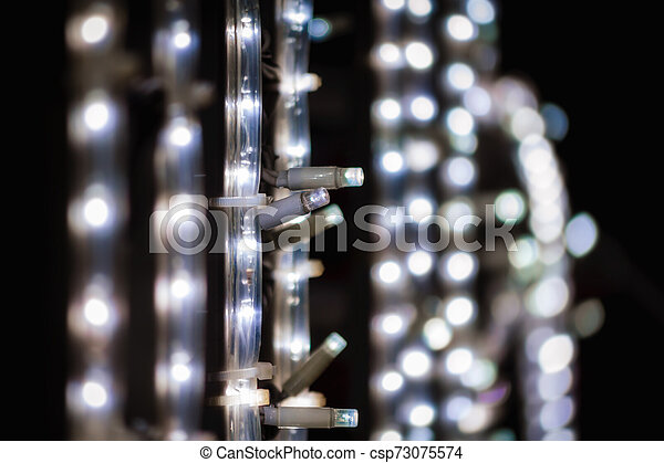 abstract background pattern small lamps on a black background close up - csp73075574