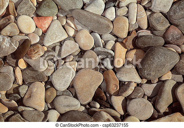 Abstract background with round peeble stones close up. - csp63237155