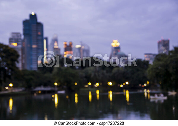 Abstract blurred background of public park in the city at night - csp47287228