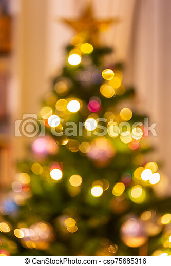 Abstract bokeh light on black background with flare. Christmas concept to present celebration wallpaper decor with beautiful glitter and sparkle bubbles in blur or defocus style for web design. - csp75685316