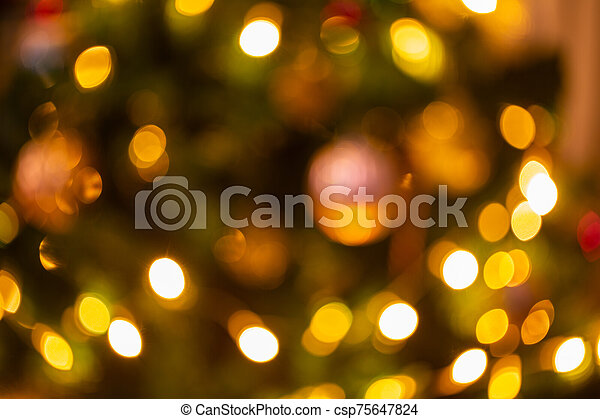 Abstract bokeh light on black background with flare. Christmas concept to present celebration wallpaper decor with beautiful glitter and sparkle bubbles in blur or defocus style for web design. - csp75647824