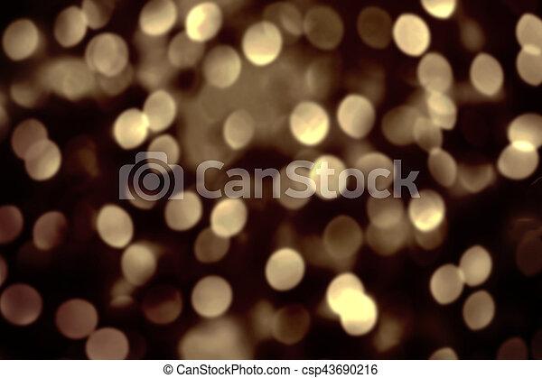 Abstract Christmas Glitter Vintage Lights Background. Dark Gold Glitter  Defocused Wallpaper With Sparkling Bokeh