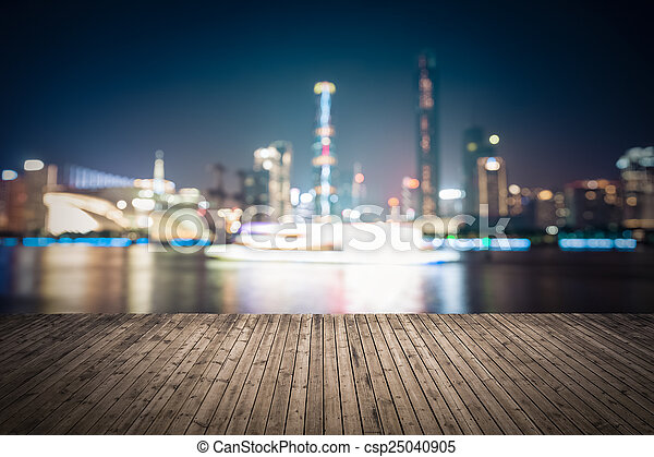 abstract cityscape background with wooden floor at night - csp25040905