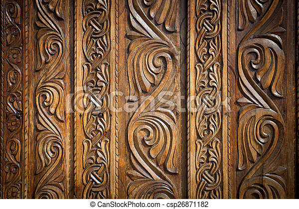 Abstract floral decoration carved on a wood door - csp26871182