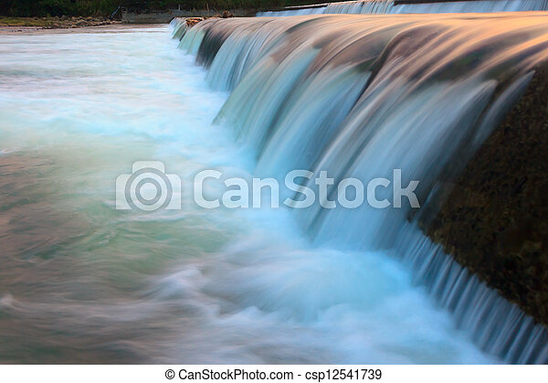 Abstract flowing water from a dam - csp12541739